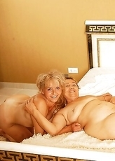 Four mature and young lesbians getting group sex
